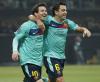 Lionel Messi i Xavi Hernández cieszą się po strzelonym golu w meczu AC Milan - FC Barcelona z 23.11.2011